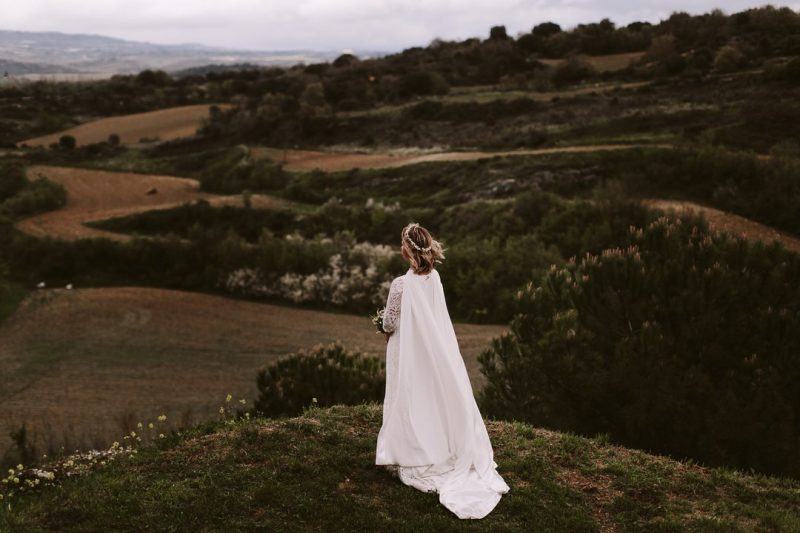 Alicia Rueda Bride with cape on mountaintop