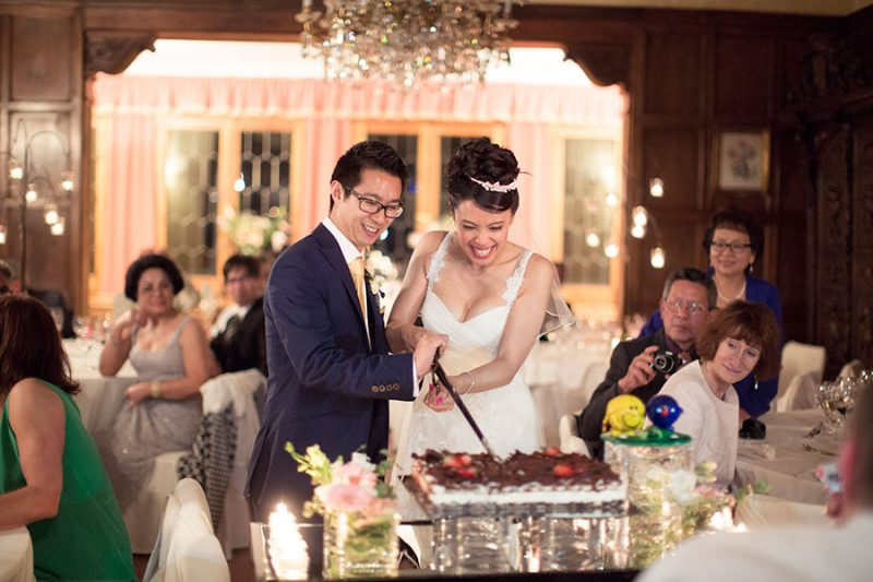 Traditional Spanish Wedding Cake being cut by Bride and Groom