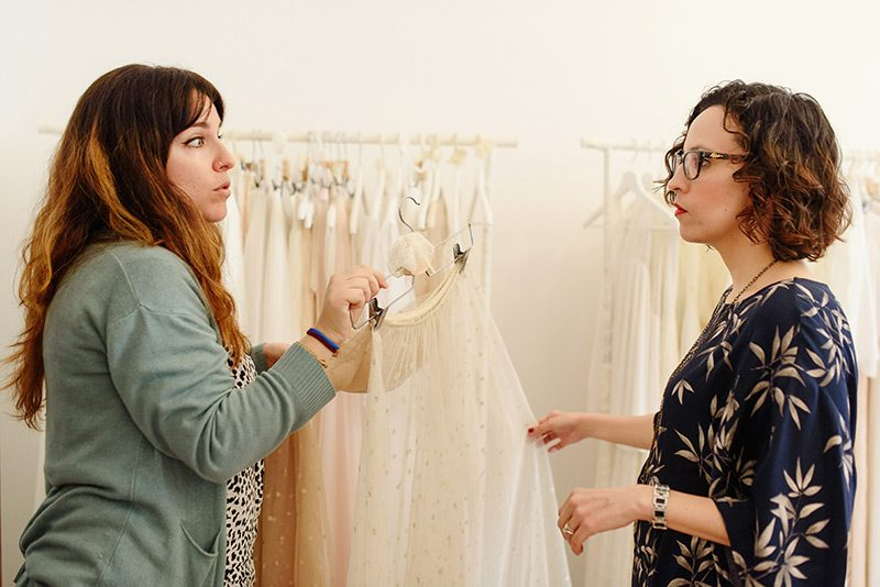 Mireia shows Laura wedding skirts at atelier