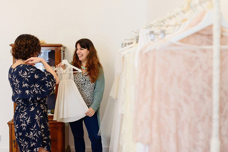 Mireia shows Crystal Events flower girls dress at atelier