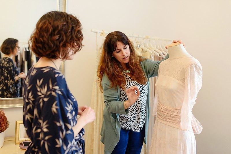 Mireia shows Crystal Events how to wrap convertible dresses